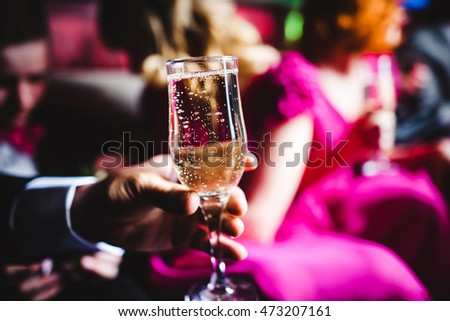Champagne and glasses on the back seat of a limousine closeup
