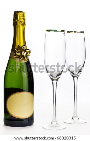 Champagne and glasses ready for celebration - stock photo