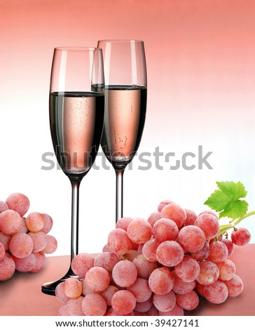 Champagne and grapes in pink color - stock photo