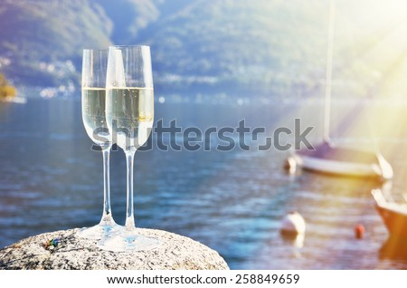 Champagne and grapes. Lake Maggiore, Switzerland - stock photo