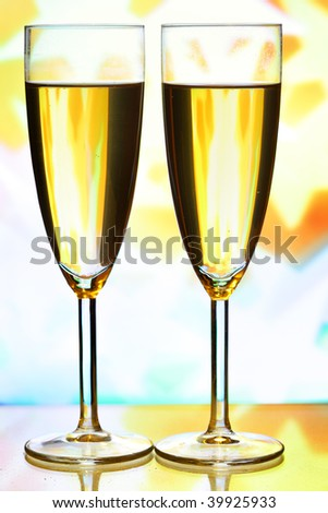 Champagne and holiday lights in the background - stock photo