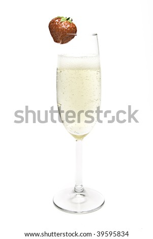 Champagne been poured in a flute with strawberry - stock photo