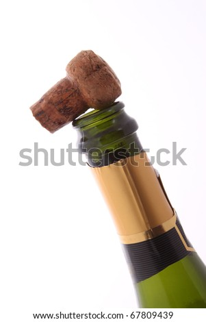 Champagne bottle and cork  on a plain white background. - stock photo