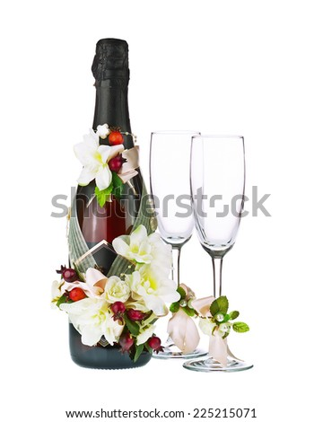 Champagne Bottle and Glass with Wedding Decoration of Flower Arrangements Isolated on White Background. - stock photo