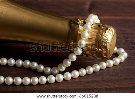 Champagne bottle and pearls for Valentine's day