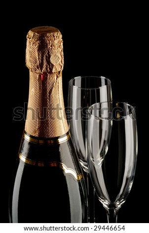 Champagne bottle and two empty flutes - stock photo