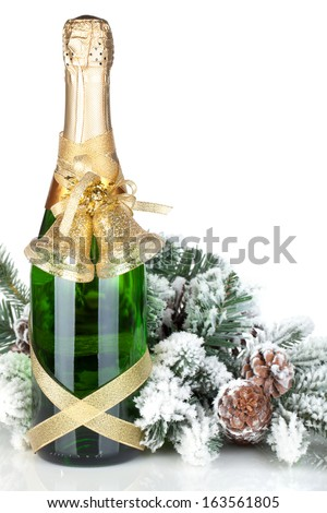 Champagne bottle, christmas decor and fir tree. Isolated on white background - stock photo