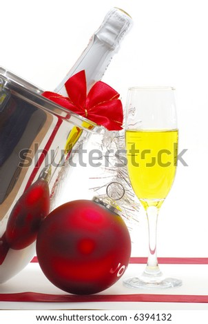 Champagne bottle, glass and some Christmas decoration - stock photo