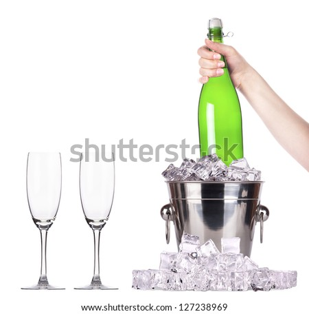 Champagne bottle in a bucket with ice isolated