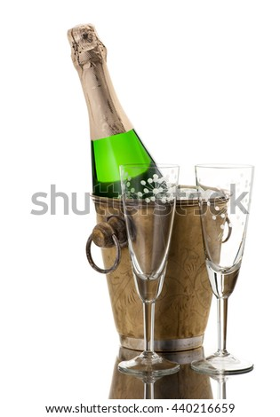 Champagne bottle in a vintage ice bucket and two glasses