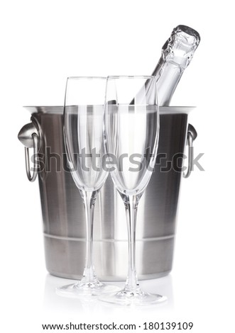 Champagne bottle in bucket and empty glasses. Isolated on white background