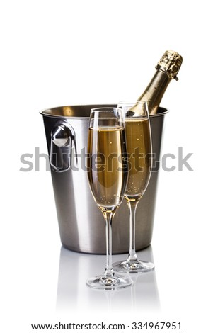 Champagne bottle in bucket with glasses of champagne and christmas balls isolated on white background - stock photo