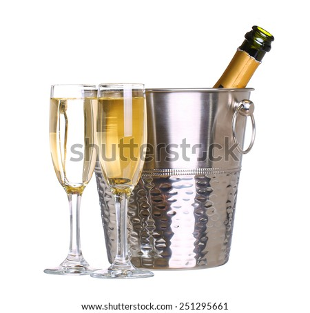 Champagne bottle in bucket with ice and glasses of champagne, isolated on white background