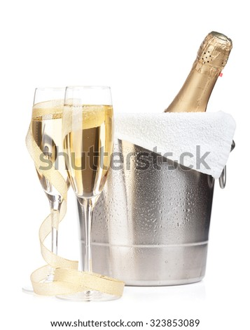 Champagne bottle in ice bucket, two glasses and christmas decor. Isolated on white background - stock photo