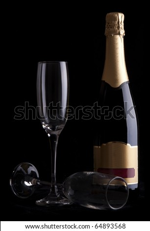 Champagne bottle isoalted against a black background - stock photo