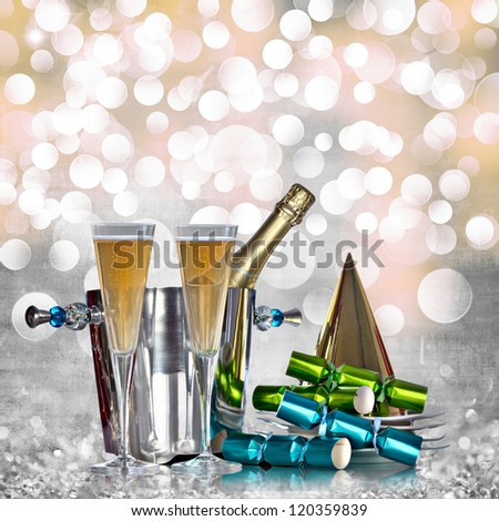 Champagne Bottle Silver Bucket Bubbly Glasses Gold Party Hat Green Blue Party Favors Elegant Vintage Grey Gold Pink Happy New Years Eve or Abstract Grunge Crystal Ice Holiday Glitter Light Background - stock photo