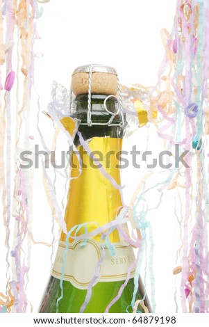 Champagne bottle surrounded by party streamers
