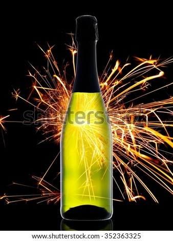 Champagne bottle with bengal fire backlight - stock photo