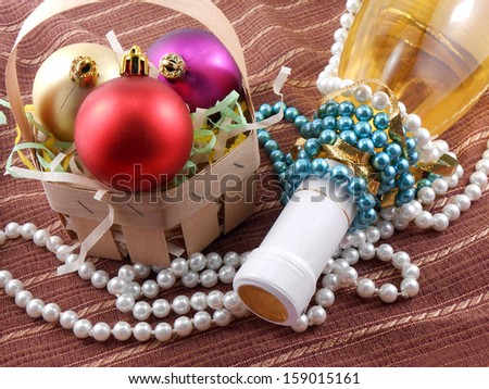 Champagne bottle with Christmas balls and diamonds - stock photo
