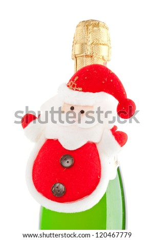 Champagne bottle with Christmas celebrating tools isolated on white