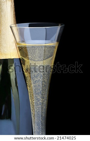 Champagne Bottle with flute over black background - stock photo