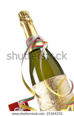 Champagne bottle with gifts, ribbons and confetti for celebrations