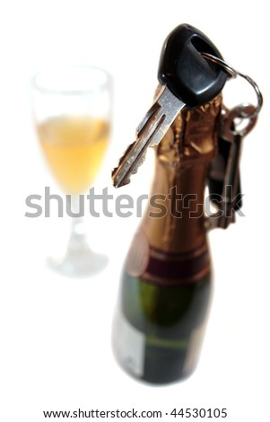 champagne bottle with keys hanging on bottle with glass on white background depicting drunk driving and addictions can kill - stock photo