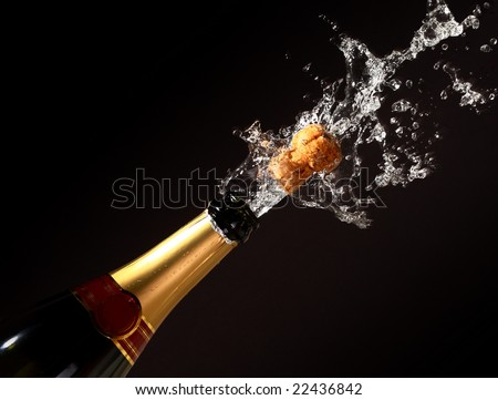 champagne bottle with shooting cork background - stock photo