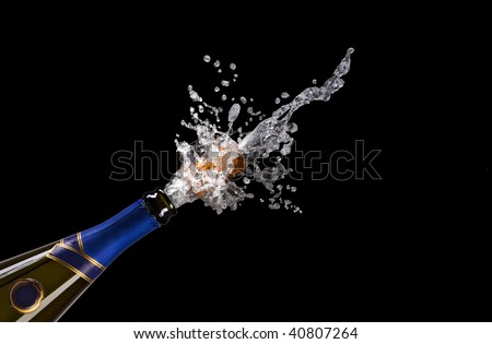 champagne bottle with shooting cork on black background - stock photo