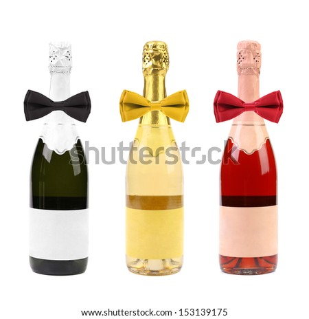 Champagne bottles and bows. - stock photo