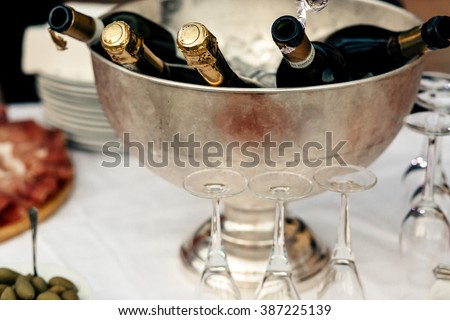 Champagne bottles in a metal bucket on a wedding table - stock photo