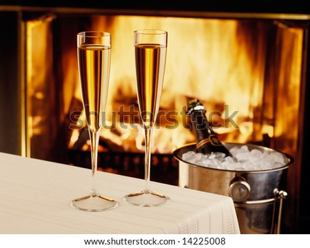 Champagne chilling by the fire - stock photo