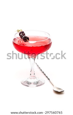 champagne cocktail at wineglass decorated with blackberry on white background - stock photo