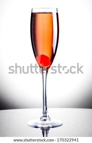 Champagne Cocktail with cherry and liquor