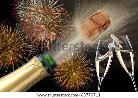Champagne cork and glass with background firework at new year - stock photo