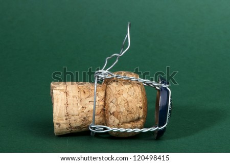 Champagne cork on green background - stock photo