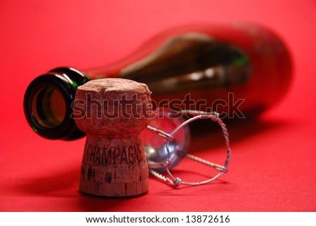 Champagne Cork with Bottle and red background