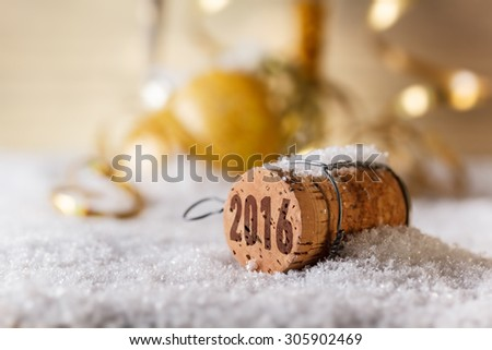 Champagne corks with 2016 year stamp in snow - stock photo