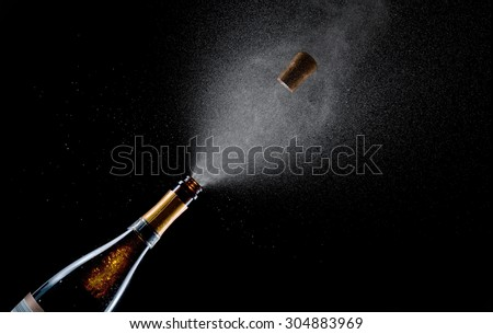Champagne explosion on black background - stock photo