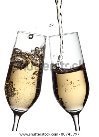 Champagne flow in champagne glasses - stock photo