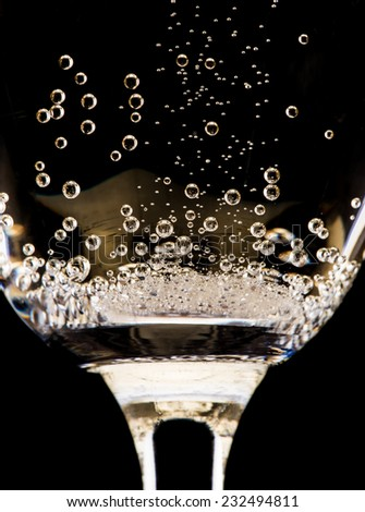 Champagne flute on black background, celebration theme. - stock photo