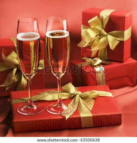 Champagne flutes and gift boxes - stock photo