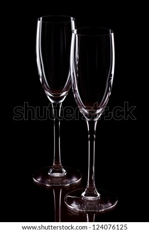 champagne flutes isolated on a black background, dark setting