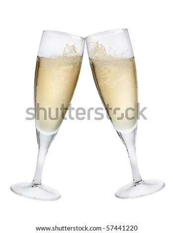 Champagne flutes making a toast isolated on white background with splashes