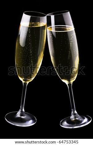 Champagne flutes on black - stock photo