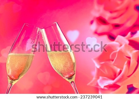 champagne flutes with golden bubbles make cheers on roses flowers background, wedding and valentine day concept - stock photo