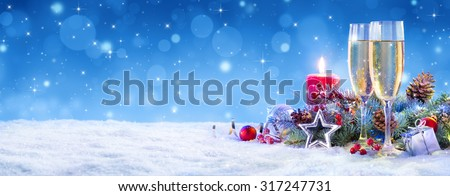Champagne For Christmas Celebration - Flutes With Candle Decoration  - stock photo
