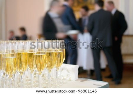 Champagne for participants of the presentation. - stock photo