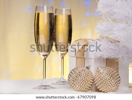 Champagne, gift box, snow and christmas toys. - stock photo