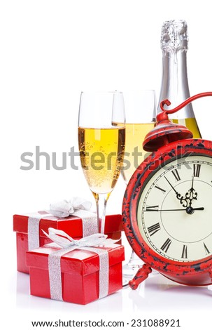 Champagne, gift boxes and christmas clock. Isolated on white background - stock photo